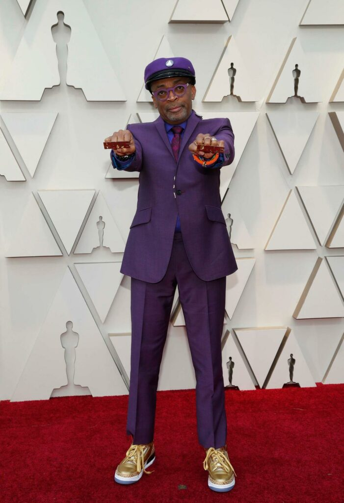 You can't really expect less from Spike Lee. I am jealous at how he wears this purple suit with golden sneakers.